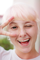 Mi hermana. (Madeline K.) Tags: portrait smile asian happy peace pixie blonde wink pinkhair circlelens