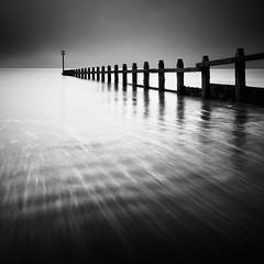Staccato (Andy Brown (mrbuk1)) Tags: longexposure seascape motion beach contrast square mono blackwhite movement devon shore marker groyne defences dawlishwarren