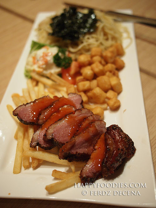 A plateful smoked Duck with Pasta