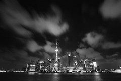 Shanghai - Amazing Night Skies over Pudong (cnmark) Tags: china shanghai pudong lujiazui famous skyline scenic night clouds amazing sky light reflections moving huangpu river 黄浦江 world financial center swfc 上海环球金融中心 jin mao 金茂大厦 pearl orient oriental tower pearloftheorienttower 东方明珠电视塔 东方明珠塔 摩天大楼 aurora shangrila 香格里拉大酒店 hotel convention 上海国际会展中心 wolkenkratzer gratteciel grattacielo rascacielo arranhacéu nacht nachtaufnahme noche nuit notte noite black white bw 中国 上海 浦东 陆家嘴 ©allrightsreserved geotagged geo:lat=3124425 geo:lon=121487224 mygearandme mygearandmepremium mygearandmebronze mygearandmesilver 6timesasnice 4timesasnice tripleniceshot 5timesasnice 7timesasnice doublyniceshot doubleniceshot longexposure langzeitbelichtung