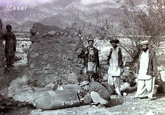 Afghan Pashtun Mujahideen's Group Examining un-exploaded Soviet Russian Bombs (Pashtun Afghan) Tags: afghanistan fight war 1988 battle soviet afghan bomb russian bombs ussr russa jihad pakhtun mujahid pashtun mujahideen jehad pashton pashtoon afghanwar afghansovietwar mujahideens