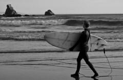 6086.3 Surfer Tether B&W (eyepiphany) Tags: oregon solitude surf surfing drama wetsuit decisivemoment blackwhitephotography oregonbeaches summerlife oregonsurfing oregontourism manzanitta smuglerscove tappingthesource bestplacestosurf bestplacestosurfinoregon dramaofthesea cominginfromaset oregonbeachtowns manzanittaoregon