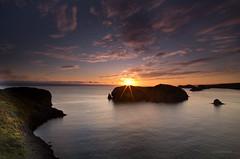 Primeras impresiones (Ahio) Tags: light sea sun sunrise shorelines seascapes surface explore sunbeam pentaxk5