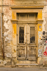 Still Beautiful (Truebritgal) Tags: door old house building yellow metal stone lens graffiti nikon bars antique entrance cyprus ornate nikkor larnaca 18200mm d7000 truebritgal