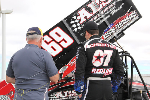 Tomas Scheckter and Bud Kaeding look over the car