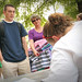 A freshman and his mother get his room number from the residence mentor outside Owen.