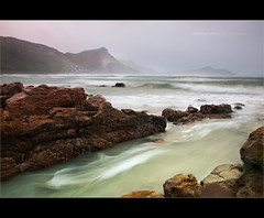 Misty Cliffs (Chantal Steyn) Tags: ocean africa seascape motion beach water landscape southafrica coast movement nikon rocks waves tripod cliffs coastal polarizer scape mistycliffs westerncape d300 cokin gndfilter turqois nd8 nohdr 1685mm