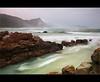 Misty Cliffs (Chantal Steyn) Tags: ocean africa seascape motion beach water landscape southafrica coast movement nikon rocks waves tripod cliffs coastal polarizer scape mistycliffs westerncape d300 cokin gndfilter turqois nd8 nohdr 1685mm