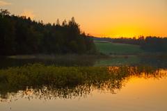 After sunset (Karmen Smolnikar) Tags: light sunset orange lake water glow hill slovenia slovenija gradisce gradie