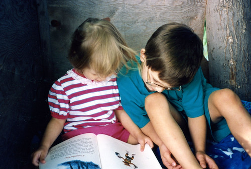 Our homeschool had lots of reading, sometimes even in a treehouse. Christina (2) and Will (7), 1992.