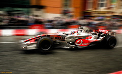 Jenson Button in Manchester (Iain Jaques) Tags: street blur silver demo mercedes crowd wing f1 motionblur mclaren formulaone british 24 vodafone formula1 v8 mp4 winglets jensonbutton f1car formulaonecar oldversion vodafonemclarenmercedes mp423 2008car ilovemanchester iainjaques manchesterdeansgate ilovemcr iheartmcr 2008championshipwinningcar vodafoneviplive
