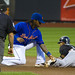 Emilio Bonifacio slides in before Jose Reyes' tag