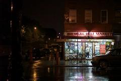 walking home (Michael Cory) Tags: street nyc storm wet water car rain sign brooklyn night reflections lights store open hurricane bodega irene greenpoint cornerstore