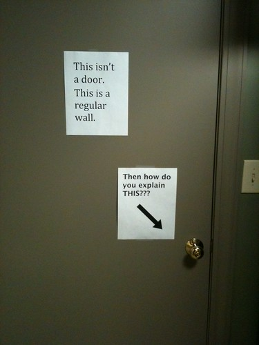 This isn't a door. It's a regular wall. (Response:) Then how do you explain this???