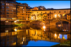 Florence - Ponte Vecchio in the Arno River (Yen Baet) Tags: city longexposure travel bridge windows italy reflection art classic water architecture night river photography 50mm prime photo florence twilight ancient europe italia arch riverside dusk scenic landmark icon tourist medieval tuscany historical firenze bluehour picturesque iconic renaissance medici starburst pontevecchio cellini arnoriver oldbridge jewelryshops benvenutocellini woodenplanks stonepillars d700 vassaricorridor