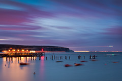 Twilight, Swanage Bay (flatworldsedge) Tags: longexposure light sea blur night clouds boats pier twilight cloudy yacht trails dorset nationaltrust isle purbeck oldharry swange yahoo:yourpictures=landscape yahoo:yourpictures=england2013
