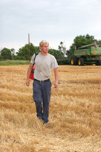 Combine parked for the evening Andreas gets ready to head home.
