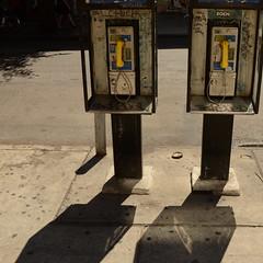 (Badison) Tags: road street nyc newyorkcity light shadow urban reflection yellow analog gum concrete graffiti nikon technology manhattan retro sidewalk gothamist dslr phones landline d7000