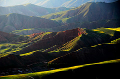 Zhuo'er mountains  (Mel@photo break) Tags: china light shadow mountains green nature field pattern mel shade layers melinda  rapeseed qinghai  qilian     chanmelmel zhuoer melindachan   zhuoermountains