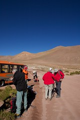 Preparing for a Hike (huskyte77) Tags: chile road street trip travel blue red vacation sky orange mountain bus green nature grass weather stone canon landscape eos high bush reisen flickr track day view desert action outdoor walk altitude group may hike clear atacama andes botanic gps travelers preparation gravel brownish travelgroup 2470mm wikinger 2011 machuca canoneos5d canonef2470mmf28l rutab245machuca regiondeantofagasta 4523t