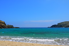 Far Side Mykonos Beach (nvangessel) Tags: ocean blue sea sky beach rock clouds trash landscape island sand rocks mediterranean waves place litter greece mykonos turqoise mikonos unedited beachscene greekisland