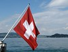 Switzerland (Libra 42) Tags: trees houses red summer vacation sky white lake water clouds switzerland boat flag hills lucerne ourdailytopic