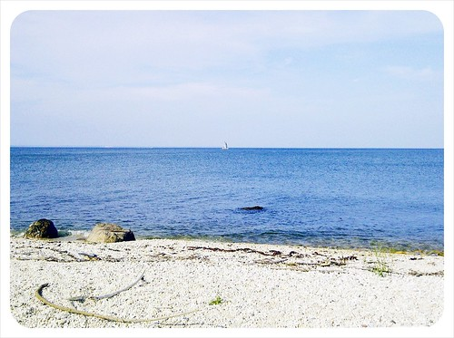 silver sailboat in the distance