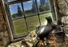Boots (Ken Yuel) Tags: ranch canada manitoba blanket pinetrees sylvain throughthewindow horseblanket ruralsetting digitalagent kenyuel cobwebsspiders teulonmb barnstonebarns windowsinbarns awindowview rubberbootswornoutboots woodenframedwindows