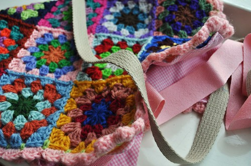 working on a crochet bag