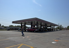 sidereal high noon at the QT (davedehetre) Tags: blue summer sky hot beer truck concrete lawrence empty clear heat kansas qt tanks fillingstation