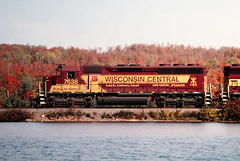 So recent, yet so long ago (view2share) Tags: 2001 trees lake fall water up mi forest october michigan foliage wc upperpeninsula ore causeway uppermichigan wisconsincentral october2001 sd45 emd northernmichigan gooselake cnw operationlifesaver specialpaint wc7638 oreline theoreline