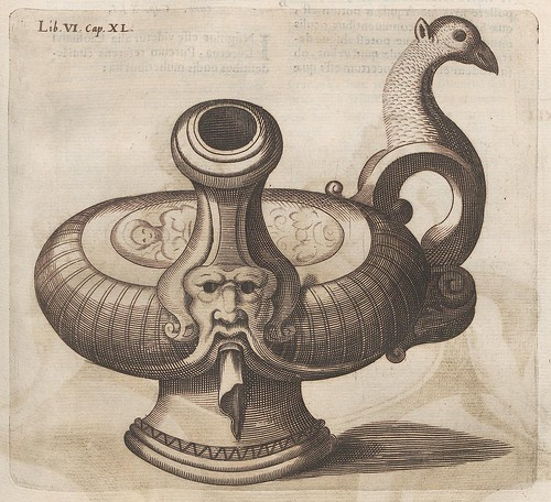 engraved design of oil lamp or candleholder with birds head and a grotesque