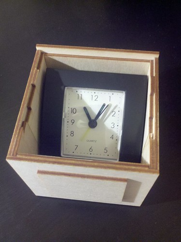 Alarm clock in puzzle box
