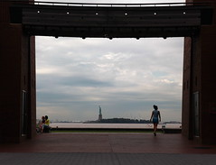 .... (sharonnord) Tags: newyork water framed lonely statueofliberty batterycitypark