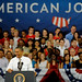 President Obama smiles large as takes to the stage.