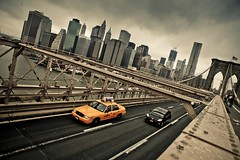 the last taxi out of Manhattan (photocillin) Tags: road new york city bridge usa apple yellow skyline brooklyn america stars big cloudy manhattan steel stripes flag taxi hcs