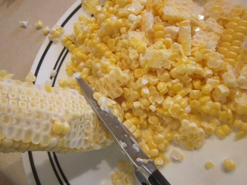 Cutting corn from cob