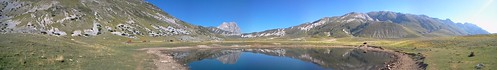 Panorama of the plain of Campo Imperatore in front of a pond