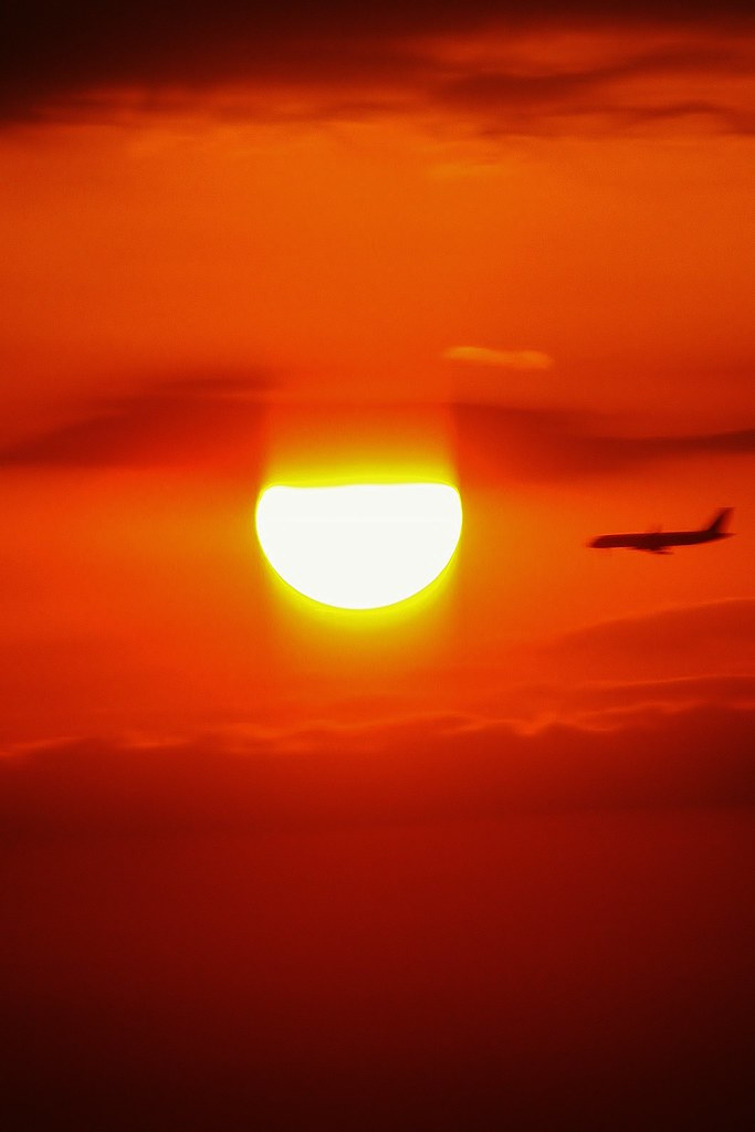 Sunset and airplane in frame image. 2011