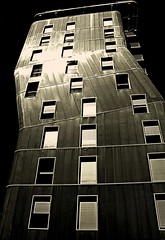 dancing in the dark (horlo) Tags: city windows wallpaper sky urban blackandwhite bw france building monochrome lines sepia architecture facade skyscraper canon reflections geotagged frankreich europa europe lyon noiretblanc curves rhne nb ciel 1984 francia reflets btiment ville confluence lignes immeuble urbain gratteciel courbes rhnealpes fonddcran blackwhitephotos