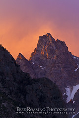 Fiery Sunrise Over Teewinot (Free Roaming Photography) Tags: light summer usa mountain snow storm mountains west nature weather sunrise nationalpark glow dramatic peak moose western northamerica wyoming teton tetons storms drama grandteton fiery grandtetonnationalpark teewinot