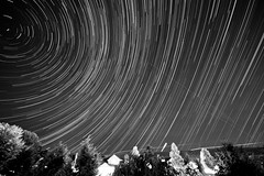 2 hours 1.5 minutes looking NNE (vladdythephotogeek) Tags: longexposure sky blackandwhite night dark star sony trail alpha startrails 2011 a550