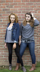 (Lottie45) Tags: blue girls two people brown brick girl wall ginger model eyes jeans persons