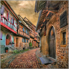 Popcorn (Jean-Michel Priaux) Tags: road windows house france architecture photoshop way nikon doors niceshot village medieval alsace ruelle rue pavel colombage patrimoine wow1 pitoresque d90 pittoresque patrimony eguisheim routeduvin priaux mygearandme