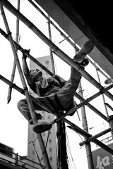 Suspended (ROSS HONG KONG) Tags: china street leica bw white black building skyline work hongkong scaffolding labor chinese bamboo repair worker poles suspended laborer causewaybay height workman superphotographer m9p