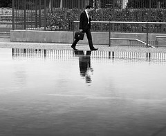 man walking // la defense, paris (pamela ross) Tags: street man paris france water pen puddle walk olympus ladefense business financial refelction ep1 penpuddlereflections