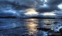 Sunset Over Kerrera (Osgoldcross Photography) Tags: sunset sea seaweed water clouds reflections island scotland boat highlands nikon rocks raw moody yacht stormy pebbles oban mast spinnaker hdr kerrera moored 3xp argyleandbute handheldhdr nikond5100