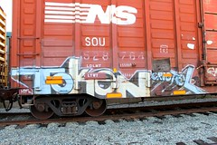 TOKEN (KNOWLEDGE IS KING_) Tags: railroad color art yard train bench graffiti paint panel ns tracks railway zee socal railcar crew boxcar token zombies burner bomb railfan freight fill wh in rollingstock