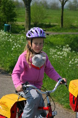 child on a bicycle (WWW.CYCLETOURS.COM) Tags: flowers cycling tulips denhaag barge keukenhof readyforspring visitholland historicalholland