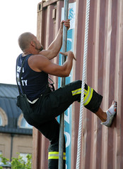 Climbing Up (Toni Kaarttinen) Tags: rescue man men guy muscles race suomi finland square fire helsinki finnland arm competition guys rope pole container climbing fireman helsingfors emergency biceps firefighter firefighters crossfire finlandia finlande crossfit